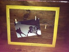 Distressed wood picture frame with chicken wire.