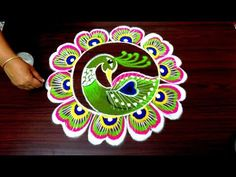 simple peacock rangoli designs for diwali Rangoli Designs Latest, Colorful Rangoli Designs, Rangoli Ideas, Rangoli Designs Diwali, Diwali Rangoli, Beautiful Rangoli Designs, Peacock Rangoli, Flower Rangoli, Rangoli Designs For Competition