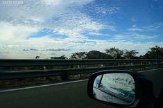 Window view.. #sujithselvanphotography #photography #camera #nikon #nikond3200 #d3200 #instagood #dslr #dslrphotography #roadtrip #car #mirror #window #windowview #road #clouds #sky #blue #white #rock #travel #travelphotography