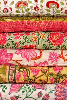Beautiful, embroidered quilts.