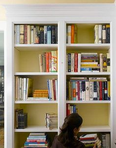 Sort books by size and subject. Remove and discard any ripped dust jackets (unless you think they might have value).