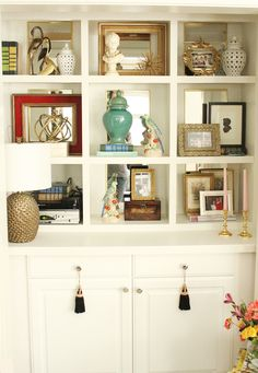 Styled Bookcase www.charmingincharlotte.blogspot.com...OK. If I went to someone's house and they had all these bookshelves with NO BOOKS on them, I could not be their friend anymore...LOL