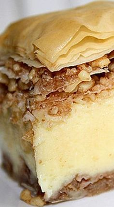 This recipe is not really Bougatsa(more like tiropita with baklava on top), but it does look like a recipe worth trying. Bougatsa - a lesser known cousin of the well known favorite baklava Greek Sweets, Greek Desserts, Just Desserts, Delicious Desserts, Dessert Recipes, Baklava Recipe, Bougatsa Recipe, Baklava Cheesecake, Galaktoboureko Recipe