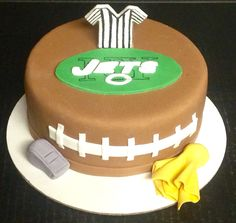 Jets, Jets, Jets! A football cake with a ref shirt, fondant whistle and yellow flag made from fondant