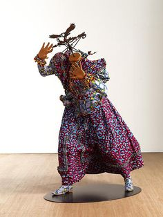 Yinka Shonibare, MBE (born 1962) is a disabled, British-Nigerian, contemporary artist living in the UK. Yink Shonibare, MBE was born in London in 1962. His family moved to Lagos, Nigeria when he was three. Shonibare contracted transverse myelitis at the age of seventeen. He returned to London to study Fine Art, first at Byam Shaw College of Art (now Central Saint Martins College of Art and Design) and then at Goldsmiths College, where he received his MFA. Shonibare considered to be a member…