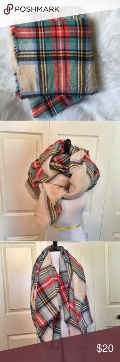 """Plaid American Eagle Blanket Scarf Plaid blanket scarf from American Eagle. Beautiful winter plaid with red, green, white, dark blue, aqua, and yellow. Little bit of fringe around the edges.   ▪️Dimensions: approx 59""""x59""""  ▪️Excellent pre-owned condition American Eagle Outfitters Accessories Scarves & Wraps"""