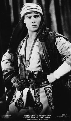 "Rudolph Valentino in ""The Son of the Sheik"", sequel to his earlier blockbuster ""The Sheik"", a term that became popular in 1920s slang to refer to men who were tall, dark and handsome like Rudolph Valentino himself."