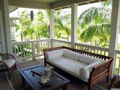 Veranda und Palmen