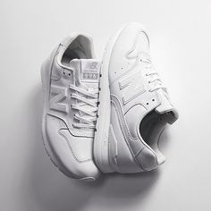 All white new balance sneakers
