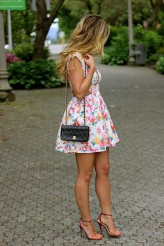 pretty floral spring/summer dress. she looks so pretty. love her heels. And her legs!