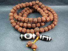 Currently at the #Catawiki auctions: A Rudraksha Mala and 2 Dzi beads - Himalayan regions - from second half of th...
