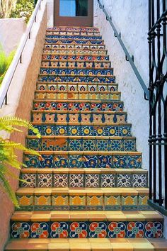Cheerfully tiled risers on staircases make them less of a chore to climb. #tile #staircase #stairs #steps #stairway #riser #Mexican #Hacienda