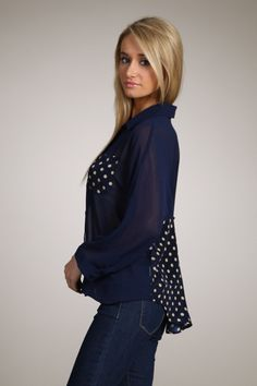 Navy, Solid, button down long sleeve top with breast pocket and polka dot inset with slight hi-lo hem. This shirt runs smaller, Sleeves are a little longer than 3/4