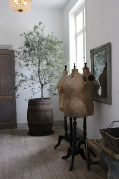 Great group of vintage dress forms love the small tree too