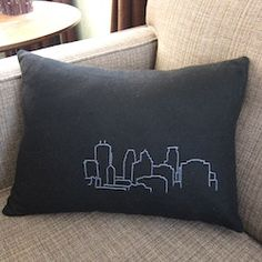 How to make an embroidered throw pillow featuring your favorite skyline.