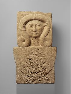 Limestone stele (shaft) with the head of Hathor  Period:     Archaic Date:     2nd quarter of the 6th century B.C. Culture:     Cypriot Medium:     Limestone
