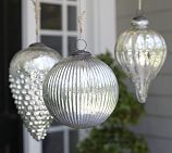 I've always adored oversized ornaments.  But the oversized prices...not so much.  I'm thinking paper mache, glitter spray paint...hmmm