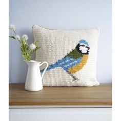 """Crochet your own Blue Tit Cushion!Inspired by woodland animals and the English countryside, this cushion is great to make with full instructions. Includes colour change chart and photos to guide you through making this delightful cushion. With a buttoned opening on the back to take the pad in or out for washing. Ideal to brighten up any seat or room and great to make for a gift!Included in the Instant Download are both the English and American versions of this patternFinished size; 16"""" x…"""