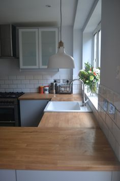 Kitchen renovation reveal. Ikea Veddinge grey kitchen with wood worktop and white subway tiles