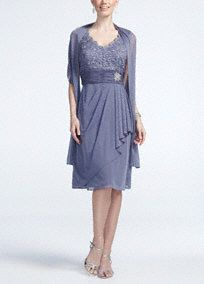 Feminine and stylish, this lace bodice jersey dress is perfect for any Mother of the Bride or Groom!  Sleeveless bodice features delicate lace bodice.  Ruched banded waist with sparkling brooch helps create a stunning silhouette.  Sheer matte jersey skirt with side ruffle adds movement.  Matching shawl adds just the right amount of coverage.  Fully lined. Back zip. Imported polyester. Dry clean.