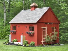A browned-off red paint job, a cupola, some stable-esque windows and new hardware, and voila.  The cheesy shed looks like a miniature country barn.   I could do that!