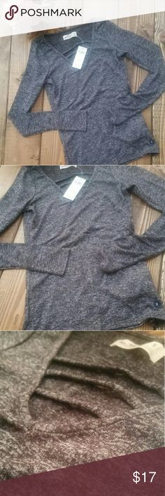 V Neck Sweater V Neck long sleeve sweater  Light weight  Cute detail at chest  Available in 3 colors   - Burgundy  - Charcoal Gray - Green All posted Hollister Tops Tees - Long Sleeve