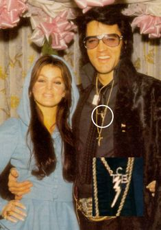 """Today 10-19 in 1970: Working from a design sketched out by his wife and himself, Elvis Presley orders a dozen 14-karat gold pendants from a Beverly Hills jeweler featuring the letters """"TCB"""" set around a lightning bolt. Designed as totems for the Memphis Mafia (and also for security issues), the symbol stands, in Elvis' words, for """"Taking Care of Business in a Flash."""" They would eventually come to symbolize the '70s era for Presley."""