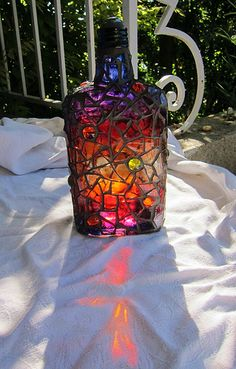 Art Tutorial - Paint bottle with glass paint, then mosaic in clear glass and cabochons and grout in dark gray - Frances Green