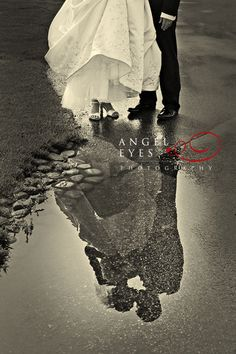 Bride and Groom reflection in puddle. Photography by Hilda Burke  http://www.angeleyesphotography.com/ http://www.angeleyesphotographyblog.com/