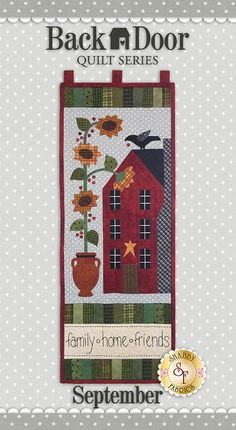 """Back Door Quilt Series Club - Pre-fused/Laser-Cut  Brighten up your home each month of the year with these beautiful 11½"""" x 30"""" wall hangings! The Backdoor Quilt Series was designed by Cottage Creek Quilts and recolored by Jennifer Bosworth of Shabby Fabrics.  All twelve wall hangings are made with flannel fabrics. This is the September design featuring a schoolhouse and sunflowers!"""