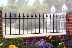 The Saxon Railings are constructed using solid steel giving a traditional wrought iron railing appearance. The decorative spear finials create an attractive wall mounted railing at an affordable price. Gates And Railings, Metal Railings, Wrought Iron Garden Gates, Iron Gates, Exterior Metal Paint, Fence Panels, Garden Fencing, Brickwork, Fence Design