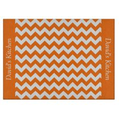 Pumpkin Orange Chevron Glass Cutting Board ..............This design features a Pumpkin Orange Chevron pattern. The TEXT on both sides (left and right) can be customized with your own name. Check out my store for more colors.