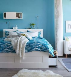 A Collection of Beautiful IKEA Bedroom Designs : Light Blue IKEA Bedroom with White Functional Frame Bed and White Small Box for Bookshelf