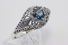 This beautiful Art Deco Style London Blue Topaz Ring is handcrafted and finished in intricate sterling silver detail. This silver ring features a very nice center mounted London Blue Topaz gemstone with 4 small accent diamonds.  $132.50  SilverMineGifts.com
