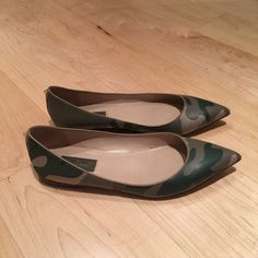 Valentino Garavani Camo Flats size 38 Great to throw on with a pair of jeans for a laid back polished look. Good condition. Does not come with original box or dustbag. Size 38. Small scratch on right toe and slight scuffs at toe tips as pictured. Price firm. Valentino Shoes Flats & Loafers