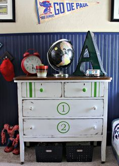 Robb Restyle: Another Painted Number Dresser. Not sure about the large numbers, but I like the stripes and colored knobs on the top drawers with white on the two larger bottom drawers.