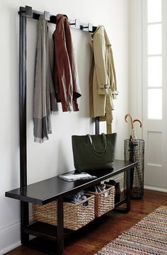 Our contemporary hall tree bench and coat rack welcome a new generation of outerwear storage, crafted entirely of iron with a durable gunmetal powdercoat finish in rich, dark bronze.