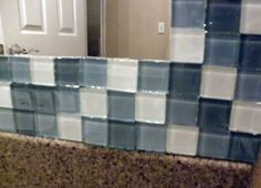 glass mosaic tiles glued to a mirror. i think this would be a perfect project for my bathroom!