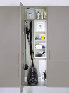 Cleaning closet storage cupboard for vacuum. The rest of the tall cupboards have large open space with a top shelf Utility Room Storage, Home Decor Kitchen, Home Organization, Cupboard Storage, Cleaning Closet, Closet Designs, Laundry Room Layouts, Cleaning Cupboard, Kitchen Cabinets Makeover