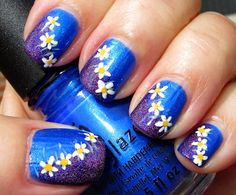 Blue with purple holo and daisies nail art