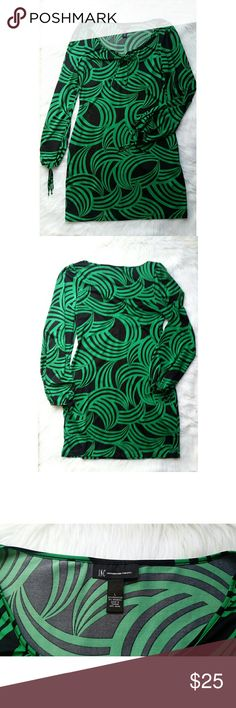 """Green and Black Spiral Dress Beautiful green and black spiral print dress. It has elastic tie sleeves and a key hole tie and the top of the collar. Flattering fit. 92% polyester and 8% spandex. 19"""" -- Shoulder 15"""" -- Length 36"""" -- Sleeve 26.5"""" -- Measures: Bust INC International Concepts Dresses"""