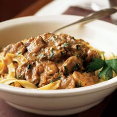 Beef Stroganoff: This #classic Russian #recipe is easy to make: use frozen chopped onions and presliced mushrooms to speed preparation. It is the perfect #comfortfood dish this #Autumn. #Fall #stroganoff | Health.com