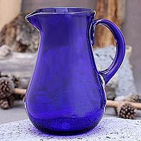Glass pitcher, 'Cobalt Charm'    Mesmerizing with its cobalt translucency, this pitcher offers the allure of Mexico's blown glass artistry. Javier and Efrén join forces in the creation of this singular piece, which is crafted with traditional blown glass techniques. The pitcher's design is elegant, voluminous and makes pouring easy.