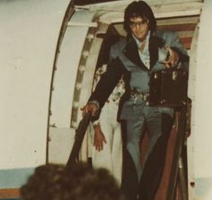 Exiting the plane 1975