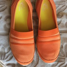 Easy Spirit fluorescent flats.  NWOT Bright orange stretchy flats with rubber soles.  Worn for a few minutes in shoe store only.  Medium width..   0328 Easy Spirit Shoes Flats & Loafers