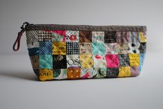Another Patchwork Pouch? Indeed, this is my favorite sewing pouch style! For some reason, I've enjoy working with tin...