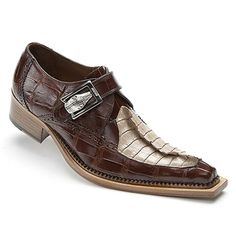 CRAFTED in ITALY from MAURI, this unique slip-on makes a strong statement! Featuring a gorgeous hand painted genuine alligator body accented with splash of genuine hornback on the foot, beautiful brogue details, strap across the vamp adorned with crocodile silver buckle, smooth leather lining, extended dress insole, & fashionable leather dress sole. Stunning and unique, just like you.