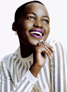 LUPITA NYONGO-BRIGHT PURPLE LIPSTICK NUDE PINK NAILS
