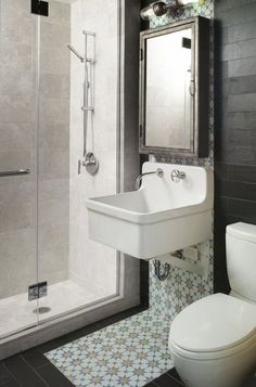 Black and white slate tiles in the guest bathroom act as a neutral shell to the vibrant Moroccan cement tile backsplash that reaches all the way under the sink.Medicine cabinet: Restoration Hardware; sink: Gilford, Kohler; light: Bilux Sconce, Fabulux