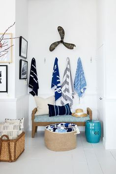 There are so many smaller vignettes throughout The Studio at One Kings Lane, like this corner of hanging beach towels and a boat propeller evoking a blissful summer day.